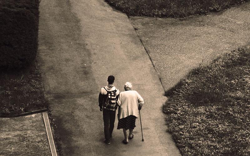 Walking with Elderly Woman