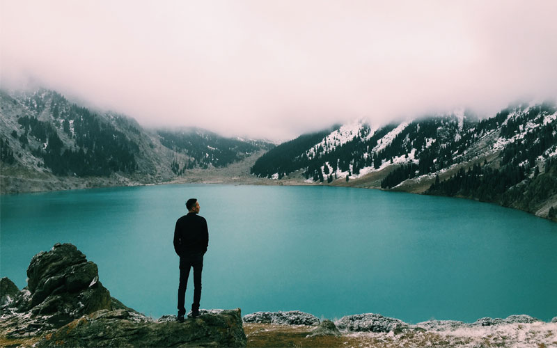 Standing by a Mountain Lake