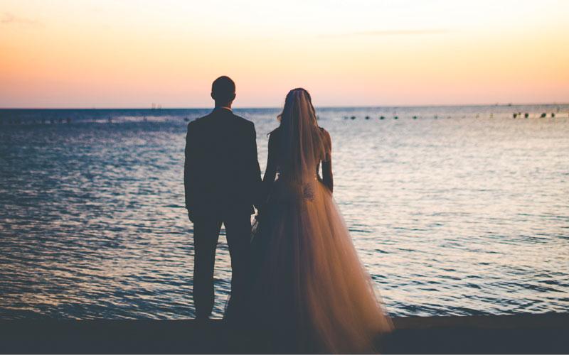 Married couple on the beach