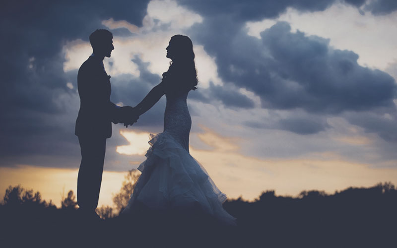 Married couple at sunset