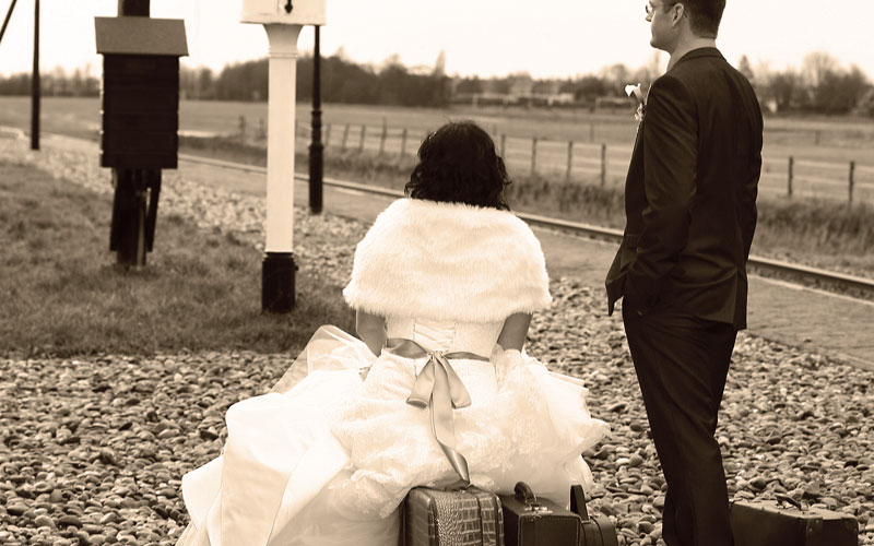 Married couple at train station