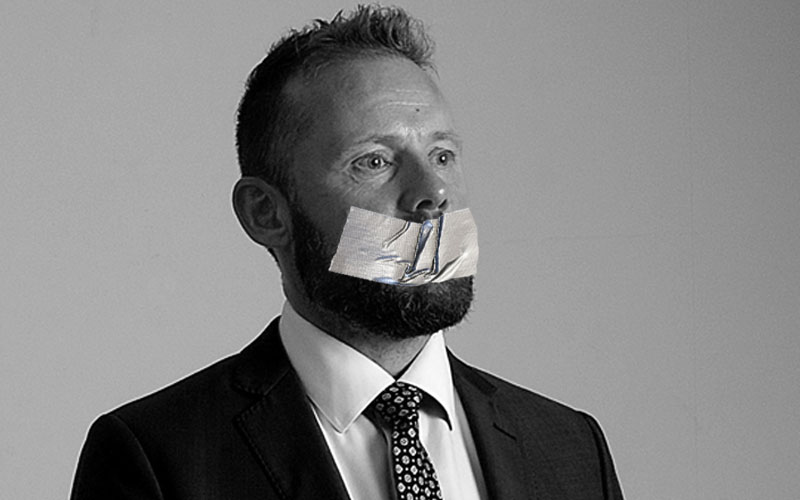 Man with duct tape over mouth