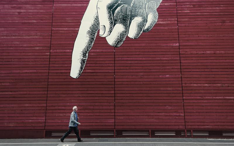 Pointing at Man
